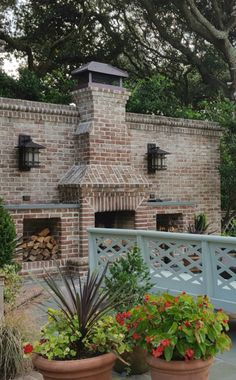 the most amazing brick outdoor fireplace. Here's a sneak peek just for you! I just love the symmetry and scale of it. It's perfect for warming you up on those cool coastal evenings.