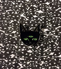 One THREE EYED CAT lapel pin with glow in the dark eyes... anything from this shop!