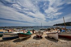 Fishing boats line the trail in Calella de Palafrugell