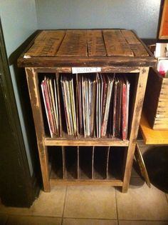 Record player stand and vinyl storage cabinet. Vintage wooden cabinet that has been sanded down. The top of the unit is made up out of antique crate slabs of wood.  www.bulletinboardfurniture.com