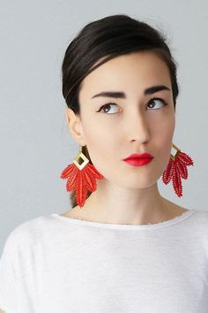 Red lace earrings punch way above their weight. #etsyjewelry
