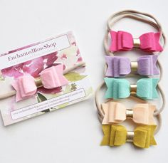 These bows are made from a quality wool blend felt. The bow measures 3 1/2 inches in length and 1 1/2 inches in width. The bows can be placed on an alligator clip or nude one size fits all nylon headband. You can order 1 bow for $5 3 for $13 Or all 6 for $25  In the notes when checking out please leave the color(s) you would like. Refer to the second photo for color names. *turnaround time is 1-2 weeks. If you need it sooner please message me and if I have the colors available I can...