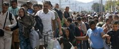 Migrants rush to board a train that would take them towards Serbia, at the railway station in the southern Macedonian town of Gevgelija, Wednesday, Aug. 19, 2015. Record numbers of migrants from countries like Syria, Iraq and Afghanistan uses the so-called Balkan route that passes trough Macedonia. (AP Photo/Darko Vojinovic)