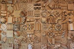 Kraft cardboard wall art sculpture based on architectural models. This design piece contains 128 distinct sculpture modules
