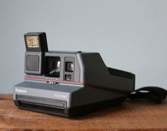 Vintage 1980s Polaroid Impulse Camera for 600 Film by VintageCrack------------------> I Want This Camera Soooooo..Bad, i just think it`ll be awesome to have one .