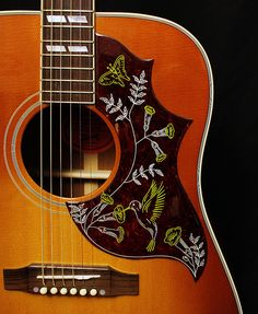 Save $950 on this Gibson classic ~ The brand new Hummingbird has the 2016 engraved truss rod cover and the fingerboard edge is softened to comfortably fit the contour of the player's hand. Also has a comprehensive Plek assisted setup for perfect action and superior performance. Together with new penetrating and finishing oil that lasts longer and maximizes woods natural vibrancy. Upgraded with LR Baggs Element VTC pickup system with Volume, Tone and Compression.