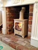 cream fireplace with red brick insert - Google Search