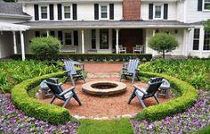 Round pea gravel patio front yard