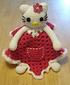 Hello Kitty Lovey Blankie by Knotty Hooker Designs - This pattern is available for $2.75 USD. Pattern Includes 3 bow patterns and 2 flower patterns so you can mix and match. Also pocket and applique patterns are included!  It measures appx. 15 inches square. Perfect for the diaper bag, car ride, crib or whatever tickles your fancy. It's smaller size makes it the perfect carry along companion for your little one. They work up quickly and easily!