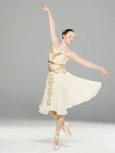 NEW! 2017 Collection Contemporary & Lyrical Costumes: Front lined spandex leotard with foil spandex bands at the waistline is adorned with beaded sequin appliques. Twisted chiffon shoulder straps sit atop attached nude shoulder straps. Attached skirt is layers of chiffon and georgette with floral appliques.  Includes headband, armband, hanger and garment bag.