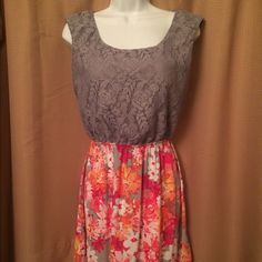 Beautiful spring dress in grey and floral print I love this dress. Only worn once and washed. Grey lace at top with lining and floral skirt at the bottom. Size 9 but I would say it also fits a small/medium. The back of the dress button is literally hanging on by a thread but that is easily fixed (: Speechless Dresses Mini