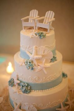 Beach / Nautical wedding / Vow renewal cake. With the chairs topper could be an Anniversary or Retirement Party cake.