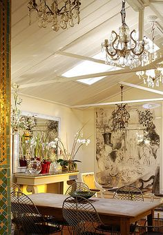 .three chandeliers... nice twist... and of course the large painting ....