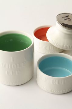 Milk Bottle Measuring Cups at Anthropologie. $24  -- I have ceramic vintage bee measuring cups, but love these.