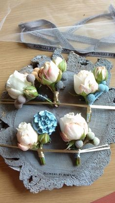 Button holes (karen's wedding) flowers by bornay