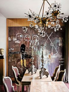 art on walls - love the edgy mix of the art, the chandelier and the dining chairs...