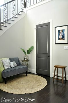 Is the Gray Home Decorating Trend Here to Stay? gray interior door in foyer plus front door & side lites Dark Interior Doors, Dark Doors, Painted Interior Doors, Grey Doors, Gray Interior, Interior Paint, Interior Design, Wood Doors, Popular Paint Colors