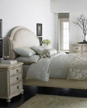 Love the romance of this soft look with the curved headboard.
