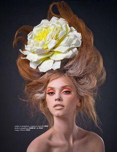 Big hair with flower and orange eye makeup x