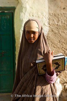 Muslim girl walking to school, Berbera, Somaliland, Somalia