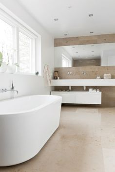 freestanding bath with wall fixtures