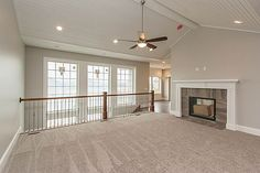 Open concept staircase with wall of windows all the way down to basement level. Staircase tucked next to foundation for efficient use of space in finished basement.