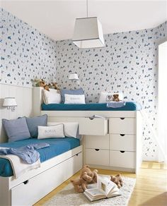 Shared room with staggered beds and built in storage.