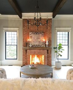 ceiling paint, dark beams, light walls, thick molding and good fireplace color