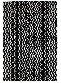 This black and white Betty Jackson rug reminds us of bicycle chains.