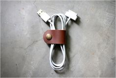 Leather cable band. An elegant solution to organize headphone or USB tangled cables.