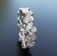 Tilted Marquise and Round Diamond Eternity Band by Joe Escobar $11.000