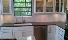 White linear wave tile kitchen backsplash and shower for Kitchen design qatar