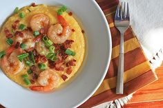 Smoky Bacon and Cheddar Shrimp and Grits, Adapted from several sources, most notably this Paula Deen recipe over at Leite's Culinaria