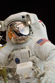 May 14, 2009 – A close-up view of astronaut John Grunsfeld performing spacewalk to do some maintenance on the Hubble Space Telescope, photographed by Andrew Feustel, who can be seen in Grunsfeld's visor. (NASA)