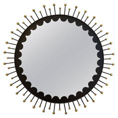 Splendid Decorative Italian Black Metal and Brass Mirror, circa 1950s | From a unique collection of antique and modern sunburst mirrors at https://www.1stdibs.com/furniture/mirrors/sunburst-mirrors/