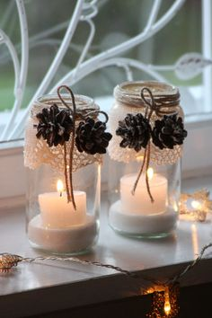 candle holders with lace & pinecones....so simple...so pretty <3