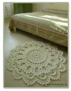 Crocheted rug. Not a free pattern, but very inspiring. (Site is Russian, but Google translates.)