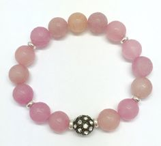 12mm faceted Rose Quartz beads with a 11mm Rhodium plated Gunmetal Cz Pave' bead Bracelet