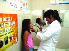 A dentist examines a child at the Policlínica Regional de Itaipu – the health clinic in Itaipu, a neighbourhood of Niterói, in Brazil.