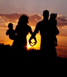 family picture silhouette in the sunset