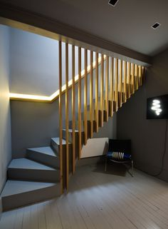 Slatted oak stairs and balustrade, oak handrail, recessed LED light, grey Farrow and Ball interior.