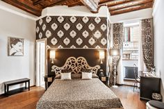 All of the Italian glamour you could want in a bedroom lies here in this home in Rome.
