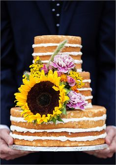 large sunflower topped naked wedding cake #weddingchicks