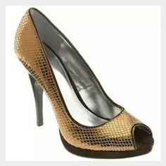 """Copper Gold Platforms Gorgeous shiny copper gold color, mini platform, snakeskin like. In excellent condition. 4"""" heel. Runs a bid large, can fit between 7.5 - 8. Calvin Klein Shoes Platforms"""