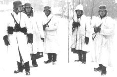 Group of Finnish soldiers during the Winter War with German M1916 helmets.