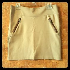 Nude fitted skirt with brown leather zips This skirt is stretchy to show off your sexy curves.  Features 2 brown faux leather zips in front as pockets. Does not actually have pockets.  Bought this from Europe and never wore it Listed brand is mother company of actual brand Offers welcome Zara Skirts
