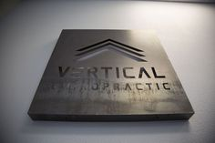 """The best way to finish our industrial theme was to mount our 36""""x36"""" 16-gauge steel logo behind our front desk. We left the metal unfinished giving it a """"time-tested"""" feel. Fabricated by Gerlinger Steel of Redding, CA."""