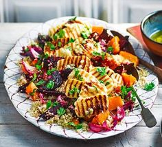 A cheese and grain salad with vibrant roast beetroot, squash and red onion. It tastes as good as it looks, plus it's 3 of your # Roasted vegetable quinoa salad with griddled halloumi Bbc Good Food Recipes, Veggie Recipes, Vegetarian Recipes, Cooking Recipes, Healthy Recipes, Vegetarian Cooking, Healthy Dishes, Hallumi Recipes, 5 A Day Recipes