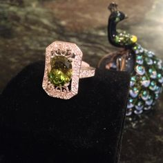 925 stamped Sterling silver ring Beautiful peridot sit in filigree stamped Sterling silver with tiny white topaz. Absolutely stunning! Jewelry Rings