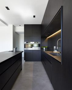 #Black kitchen! The M House is designed by DKO Architecture and is located in #Melbourne #Australia // Photo by Peter Bennetts #restlessarch